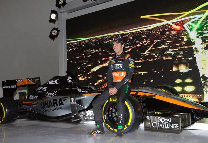 El piloto de Fórmula Uno, Sergio 'Checo' Pérez, aseguró que no debe distraerse por estar en su país para conseguir un buen resultado. Esto con respecto al regreso de la 'categoría reina del automovilismo' a México que se realizará del 30 de octubre al 1 de noviembre. (Archivo Notimex)