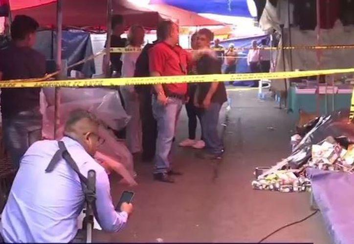Hombres armados dispararon en diferentes ocasiones contra una pareja. (Noticieros Televisa).
