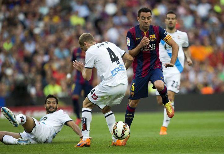 Xavi Hernández jugó como titular su último partido con Barcelona, que ganaba 2-0 al Deportivo La Coruña, pero el partido correspondiente a la última fecha de la Liga de España terminó 2-2. (EFE)