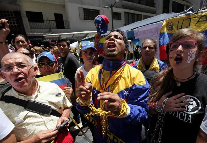 Manifestantes tomaron las calles de Caracas en protesta. (Agencias)