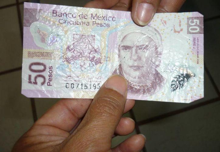 La Policía Municipal señaló que hasta el momento sólo se han detectado billetes en mal estado. (Contexto/Internet)