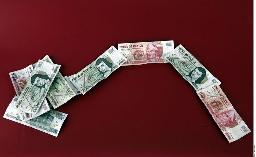 El conflicto comercial entre China y Estados Unidos, que también impactarían al crecimiento económico de México. (Foto: Reforma)