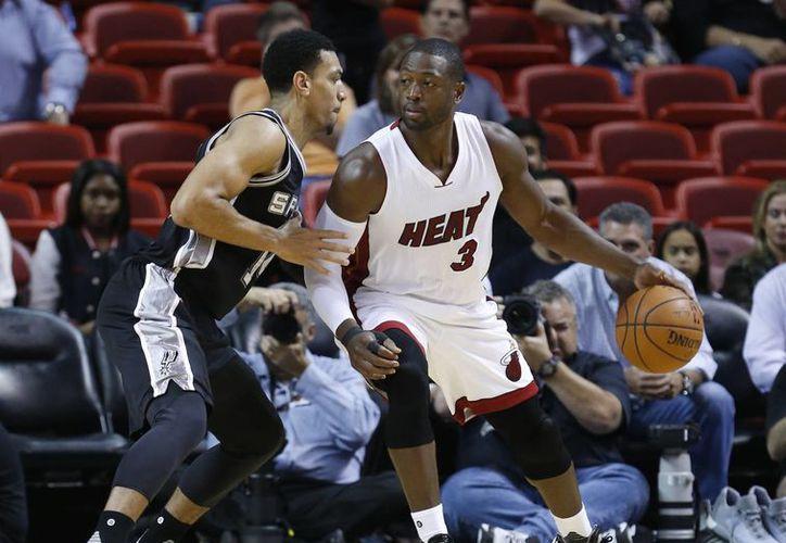 Dwayne Wade fue uno de los artífices en el triunfo de Miami Heat sobre Timberwolves de Minnesota. (AP)
