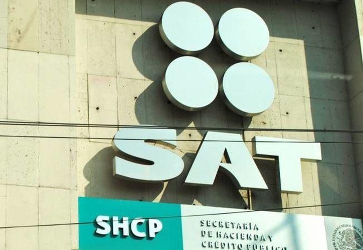 El SAT puede divulgar el nombre de contribuyentes incumplidos gracias a las facultades que le otorga la reforma hacendaria. (Archivo/SIPSE)