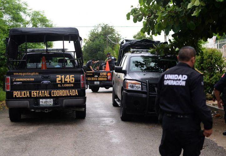Imagen del operativo que se realizó en San Antonio Kaua III para detener a una banda de robacoches. (Milenio Novedades)