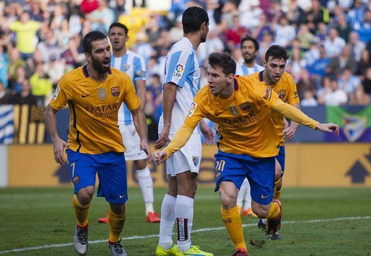 El astro Lionel Messi sentenció el encuentro con un 2-1 al minuto 51 al rematar al centro de la portería del cuadro local, en el partido entre Barcelona y Málaga. (AP)