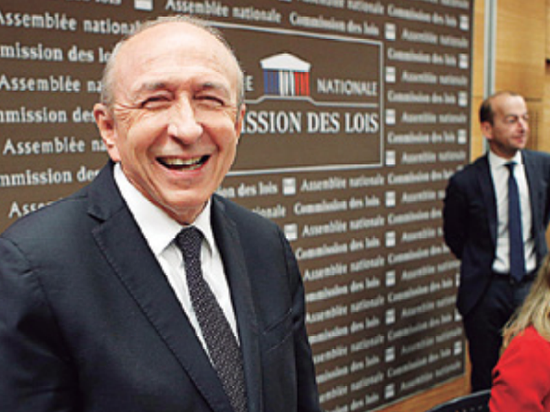 French Interior Minister Gerard Collomb, left, arrives for a hearing with the deputies of the Laws Commission concerning the case of President Macron's security aide Alexandre Benalla.