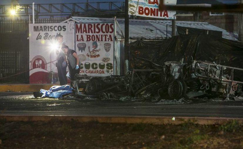 La defensa de El Chapo Guzmán niega la vinculación de los dos hijos del capo con el ataque que sufrieron miembros del Ejército en Culiacán, Sinaloa, la madrugada del viernes. (AP/Rashide Frias)