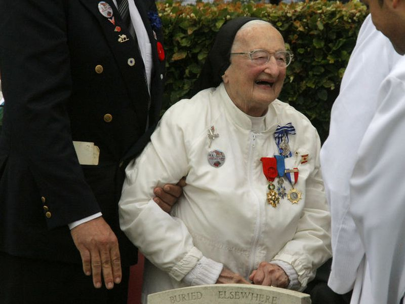 Sister Agnes-Marie Valois attends the commemorations to honor Allied soldiers killed 70 years ago in a failed World War II invasion, which took place at the Cemetery of Virtues in Dieppe, northern France.