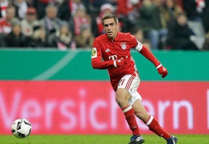 El futbolista alemán Philip Lahm, de 33 años, ha jugado 20 temporadas completas con el Bayern Múnich de la Liga de Alemania.(Archivo/AP)