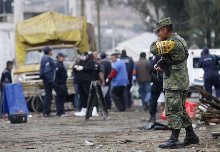 El informe alude a la violencia vivida en los estados mexicanos de Michoacán y Guerrero, donde grupos de autodefensas combate tanto al gobierno como a los carteles locales. Archivo/EFE)