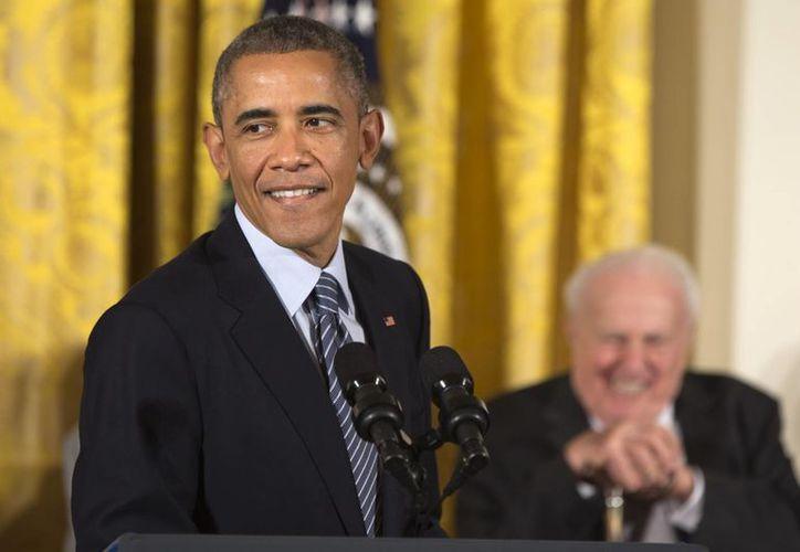 El jueves, el presidente Barack Obama anunció que haría uso de la acción ejecutiva para proteger a cinco millones de inmigrantes indocumentados. (Agencias)