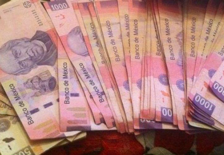En 2009 se hacían 87.4 billetes falsos por cada millón, en 2010 subió a 95.5 piezas y para 2011 la cifra llegó a 104. (Archivo/Notimex)