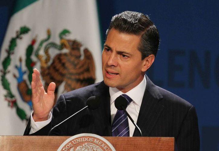 Enrique Peña Nieto durante su participación en el The Economist México Summit 2013. (Notimex)