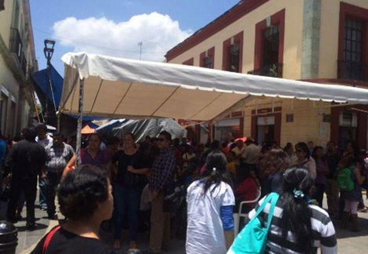 La CNTE amplió su plantón en el zócalo de Oaxaca. Buscan la libertad de los maestros detenidos. (Óscar Rodríguez/Milenio)