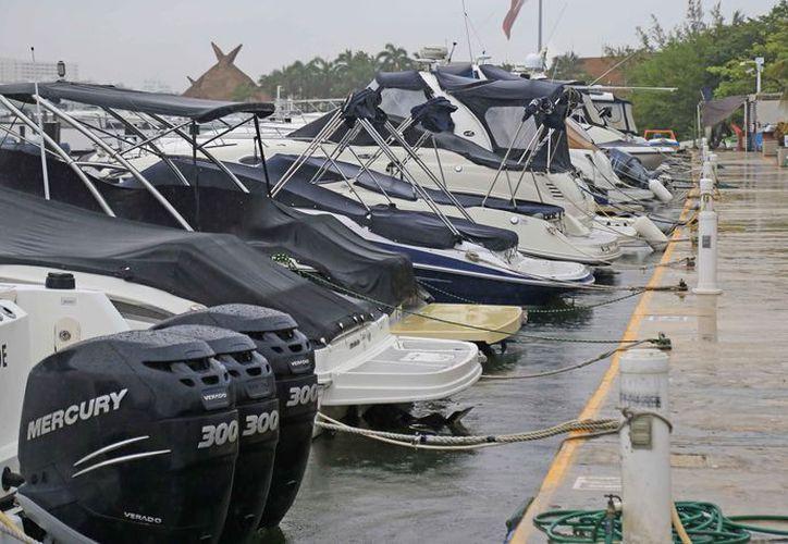 Existen posibilidades de que se abra el puerto parcialmente a las embarcaciones. (Jesús Tijerina/SIPSE)