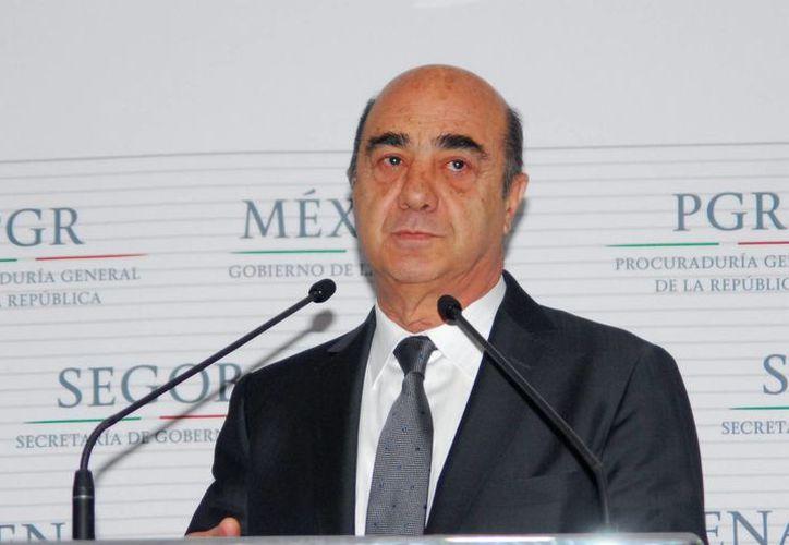 Murillo Karam aseguró que la investigación sobre el caso Iguala no será cerrada hasta detener a todos los responsables. (Notimex)