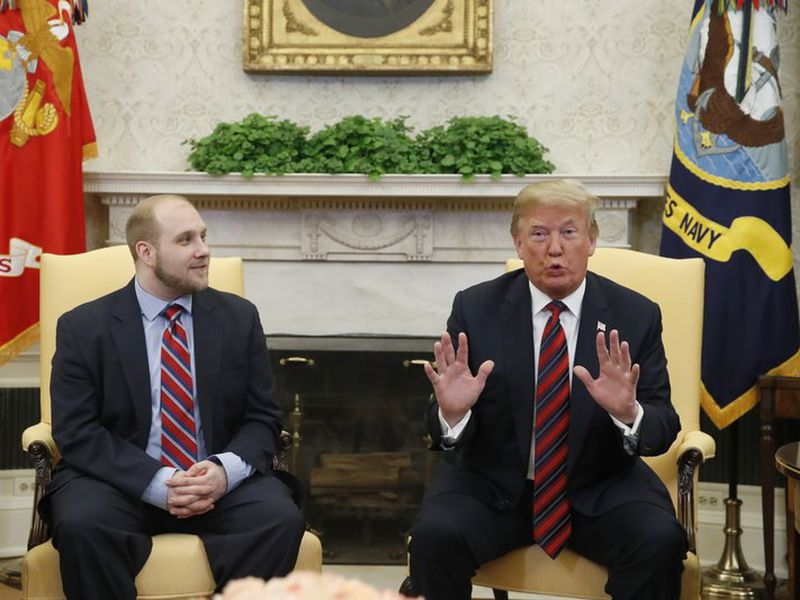 Trump, right, talks as Joshua Holt, who was recently released from a prison in Venezuela, joins him in the Oval Office of the White House, Saturday, May 26, 2018, in Washington. (AP)