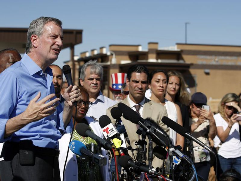 In this Thursday, June 21, 2018, file photo, New York Mayor Bill de Blasio speaks alongside a group of other U.S. mayors during a news conference outside a holding facility for immigrant children in Tornillo, Texas. (AP)