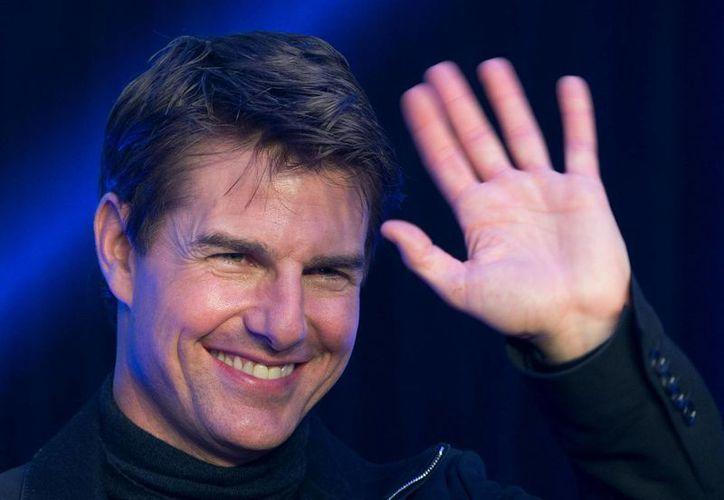 Tom Cruise acaparó portadas en 2012 por divorciarse de Katie Holmes. (Agencias)