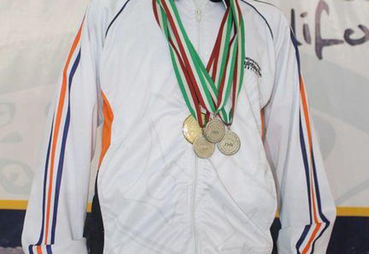 Amir Interian logró el metal dorado por puntos en su categoría. (Redacción/SIPSE)