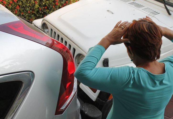A pesar que la ley de Tránsito en Cancún obliga a contar con un seguro de responsabilidad civil, mucha gente aún no se hace con una póliza. (Jesús Tijerina/SIPSE)