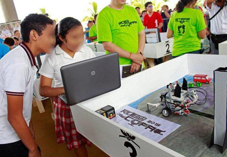 El creciente interés por la robótica en Yucatán llevó a un grupo de personas a organizar la RoboCopa 2015 (foto). La empresas Yougui, una de las participantes, desarrolla actualmente un proyecto para incorporar la disciplina en la educación formal. (Archivo/Milenio Novedades)