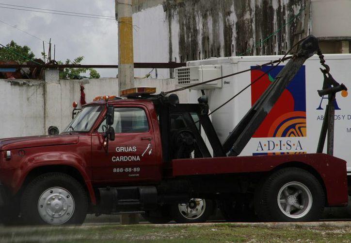 Se busca que Tránsito Municipal no otorgue el servicio de arrastre a la empresa Grúas Cardona. (Tomás Álvarez/SIPSE)
