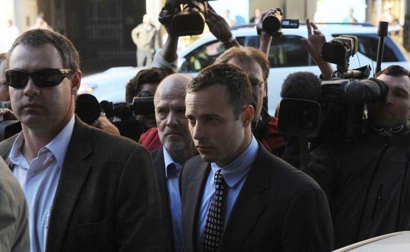 El juicio contra Pistorius por el asesinato de su novia comenzará formalmente el 3 de marzo de 2014. (Agencias/Foto de archivo)