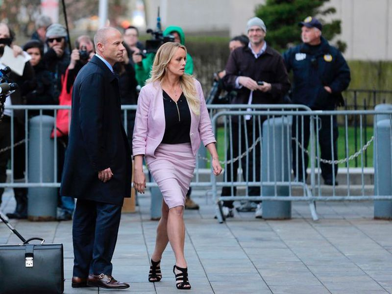 Porn actress Stormy Daniels, accompanied by her attorney, Michael Avenatti, left, leaves federal court, in New York. A federal judge is set to hear arguments about whether to delay the case of Daniels. (AP)