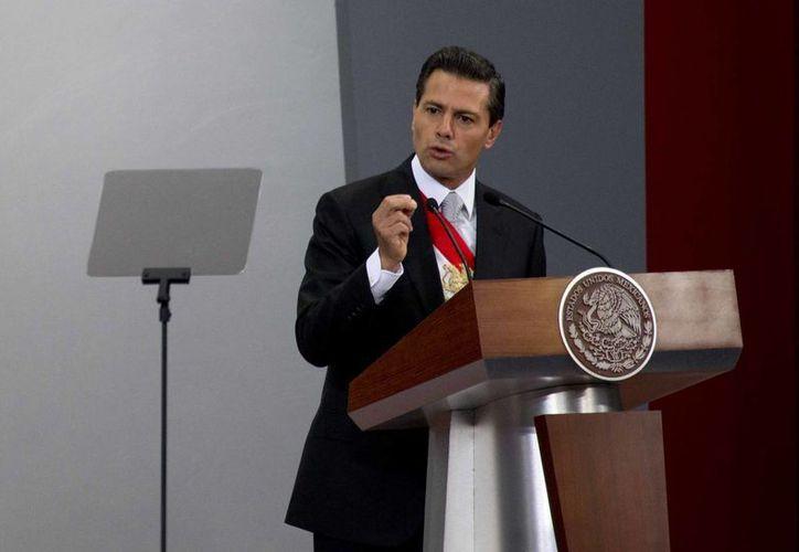 En su Segundo Informe de Gobierno, Peña Nieto indicó que el programa Oportunidades, ahora Progresa, atiende a 6.1 millones de mexicanos. (AP)