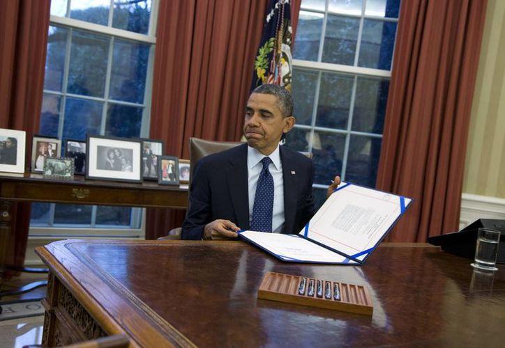 Obama insistió en que la ley le impide tomar medidas unilaterales. (Agencias)
