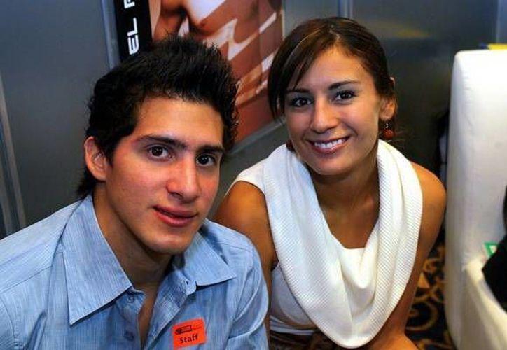 Rommel Pacheco, con su novia Paola Espinoza, una de las mejores clavadistas mexicanas de los últimos años. (Milenio Novedades)