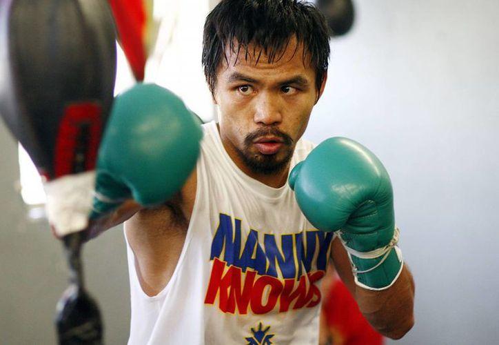 Pacquiao tiene ya 35 años, edad en la que la mayoría de los boxeadores comienza a perder velocidad. (vivelohoy.com)