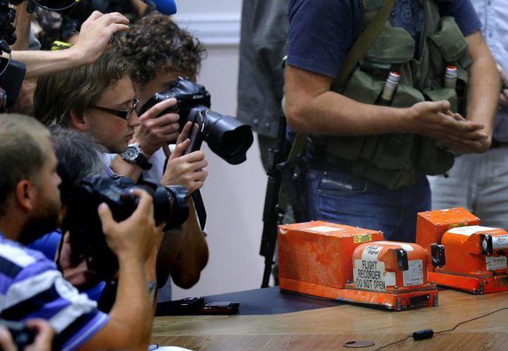 Representantes de Malasia indicaron que al parecer las cajas negras están intactas. (EFE)