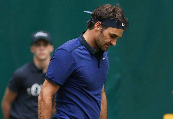 Roger Federer es el máximo ganador del Torneo Halle, al contar con ocho títulos de la famosa competencia de hierba.(AP)