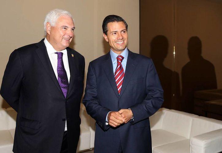 Reunión entre el presidente de México, Enrique Peña Nieto, y su homólogo de Panamá,  Ricardo Martinelli Berrocal, en el marco de la firma del Tratado de Libre Comercio, en abril de este año. (Notimex/Archivo)