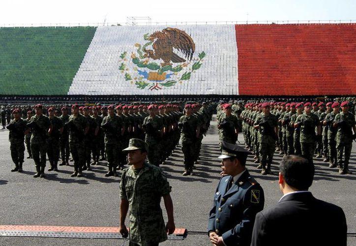 Son 669 los miembros de las Fuerzas Armadas que recibieron un ascenso. (Notimex)