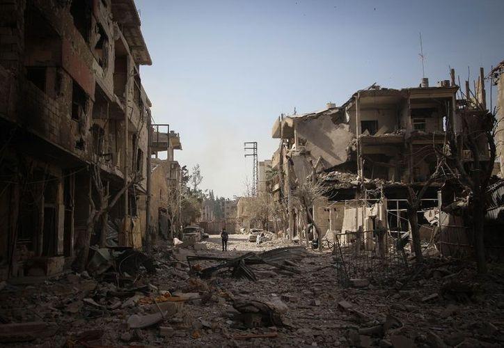 Tres civiles fallecieron por los bombardeos en la localidad de Arbin. (DPA)
