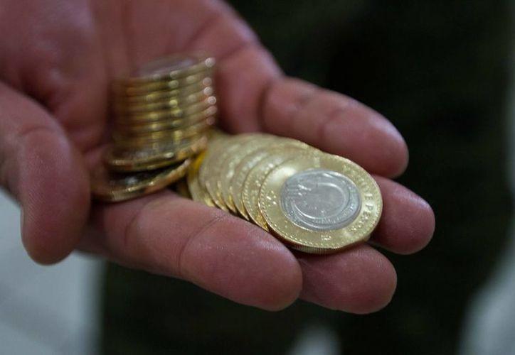 La divisa mexicana se encuentra sólo por debajo de las monedas del G7. (Notimex)