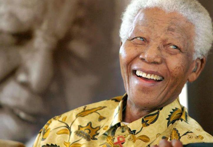 Mandela falleció el pasado diciembre sin reconocer a alguna de sus hijas que al parecer tuvo fuera del matrimonio. (Agencias)