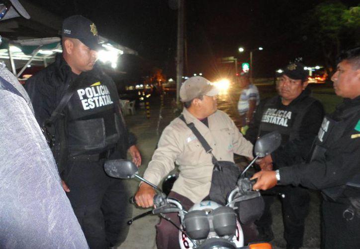 Jorge Alberto Canul Caamal se negaba a descender de la moto. (Fernando Poó/SIPSE)