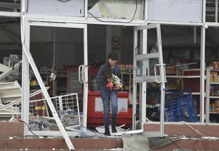 Tienda de conveniencia en Los Cabos, Baja California, dañada a consecuencia del paso del huracán Odile. (Foto: AP)