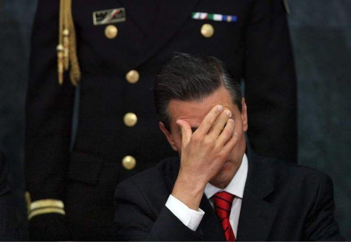 El mexicano Enrique Peña Nieto ha visto cómo su agenda pro empresarial se ha descarrilado por acusaciones de corrupción y la desaparición de 43 estudiantes. (Imagen de archivo/Agencias)