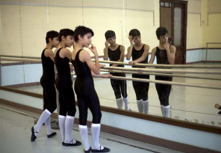 A los instructores de César, Marcos y Ángel les cuesta diferenciarlos. (Agencias)