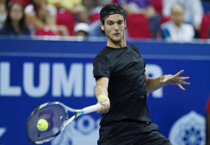 Sousa, número 77 del ranking mundial, inició en desventaja, aunque supo sobreponerse y para ganar por parciales de 2-6, 7-5 y 6-4. (Agencias)