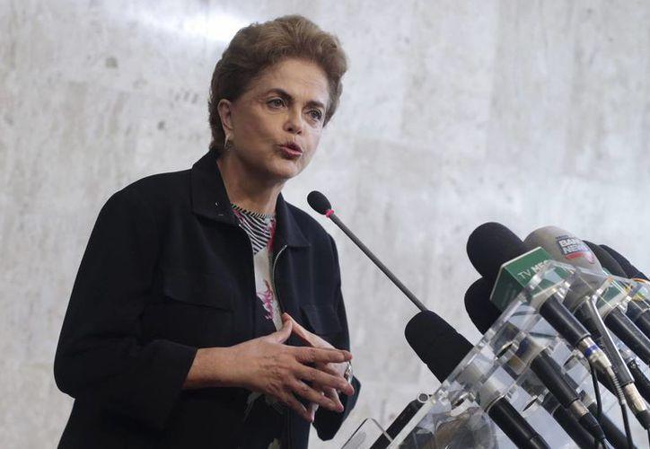 Es la primera vez que la presidenta Dilma habla directamente sobre la posibilidad de integrar a Lula da Silva a su gabinete. (AP)