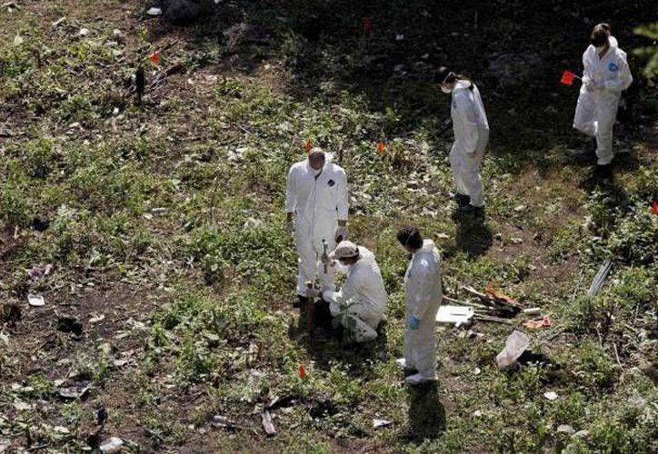 Las investigaciones presentadas por la PGR, afirmaban que los 43 normalistas habían sido calcinados en el basurero de Cocula, pero la CIDH desestimó esa versión (Archivo/Reuters)