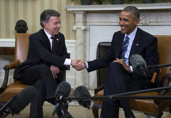 El presidente de Estados Unidos, Barack Obama se reunió con su homólogo de Colombia, Juan Manuel Santos este jueves en la Casa Blanca. (EFE)