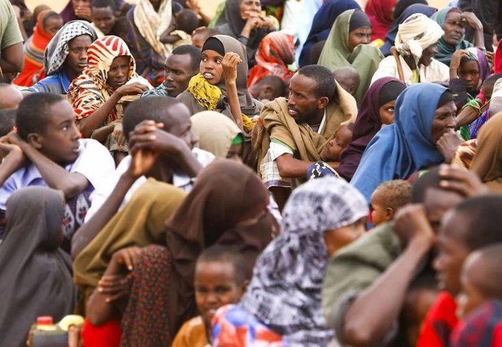 Inmigrantes desplazados de sus países, se encuentran refugiados en Sudáfrica. (EFE)